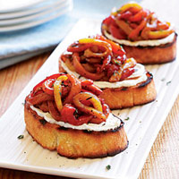 grilled-goat-cheese-crostini-with-a-tangle-of-marinated-roasted-peppers